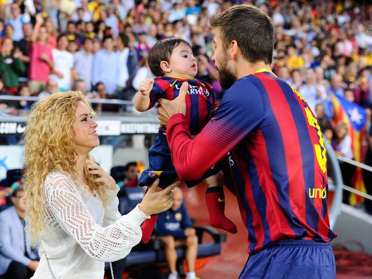 Shakira and Gerard Pique of FC Barcelona are seen with their son Milan prior to the La Liga match between FC Barcelona and Sevilla FC.