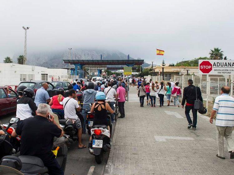 Motorists queue to cross the border between Spain and Gibraltar in La Linea de la Concepcion on September 20, 2013.