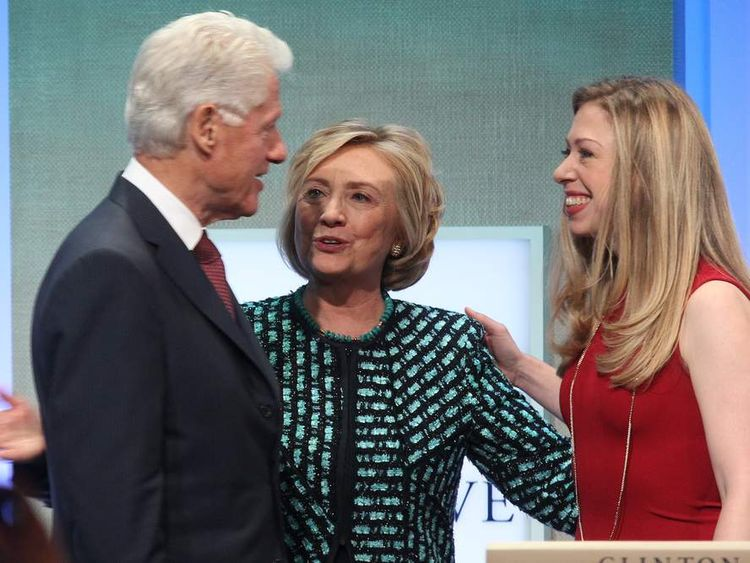 Former US President Bill Clinton (L), Former US Secretary of State Hillary Clinton (C) and daughter Chelsea Clinton