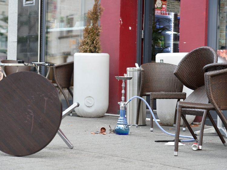 Chairs and a table in front of a restaurant in Reutlingen, Germany, where a Syrian asylum-seeker killed a woman and injured two people with a machete