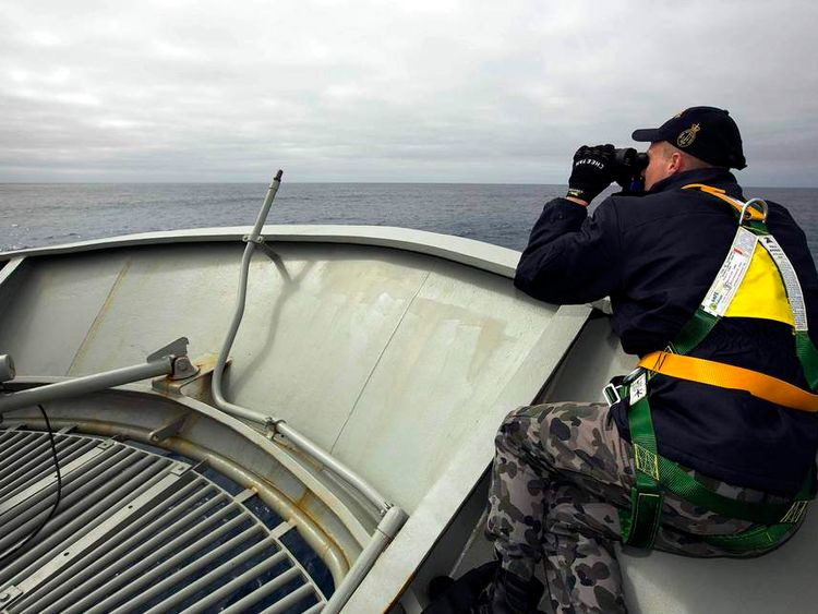 Able Seaman Kurt Jackson keeps watch on the forecastle of the Australian Navy ship the HMAS Success in a search area for missing Malaysian Airlines flight MH370