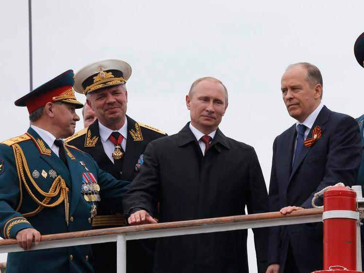Russian President Putin, Defence Minister Shoigu, Vice Admiral Vitko and FSB director Bortnikov watch events marking Victory Day in Sevastopol