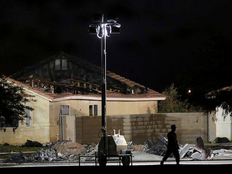 Investigators inspect the scene of a U.S. military jet crash in Imperial, California.