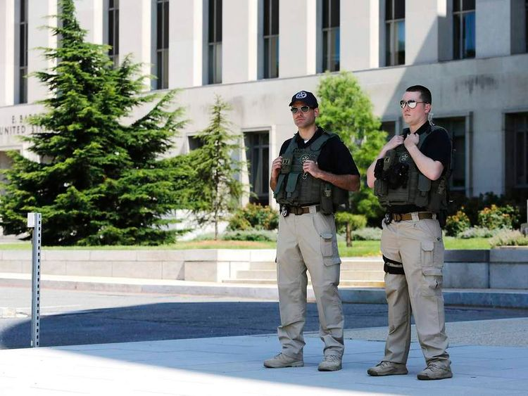 US Federal Marshals patrol outside the federal courthouse in Washington.