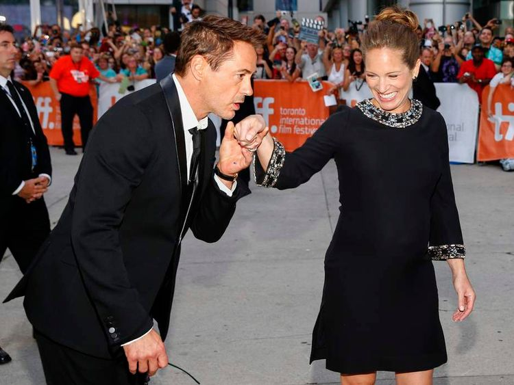 """Cast member and executive producer Robert Downey Jr. and his wife, producer Susan Downey pose as they arrive at the gala for the film """"The Judge"""" at the Toronto International Film Festival in Toronto"""