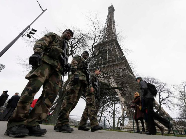 """French soldiers patrol near the Eiffel Tower in Paris as part of the """"Vigipirate"""" security plan"""