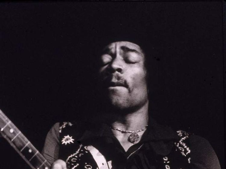 Jimi Hendrix performs on stage in the late 1960s