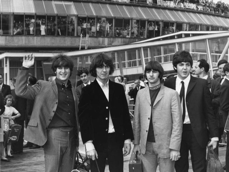 Beatles at London Airport preparing to depart for US tour in August 1965
