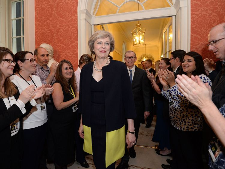 Staff clap as new Prime Minister Theresa May walks into 10 Downing Street