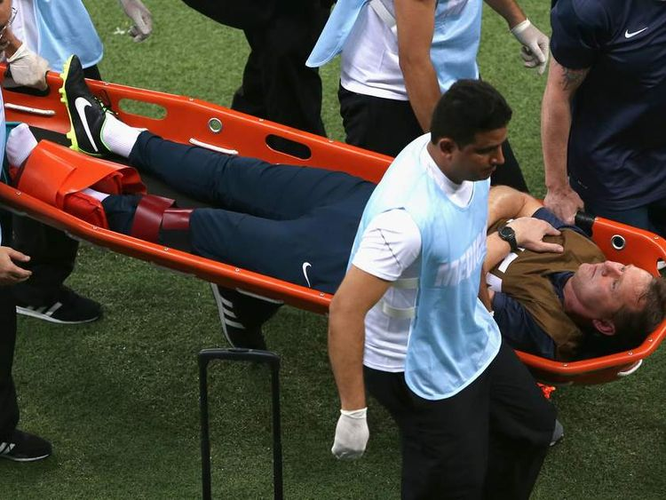 England physio Gary Lewin is carried off after breaking and dislocating his ankle while celebrating a goal.