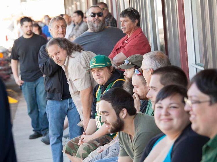 Customers wait in line at Top Shelf Cannabis, a retail marijuana store, on July 8, 2014 in Bellingham, Washington
