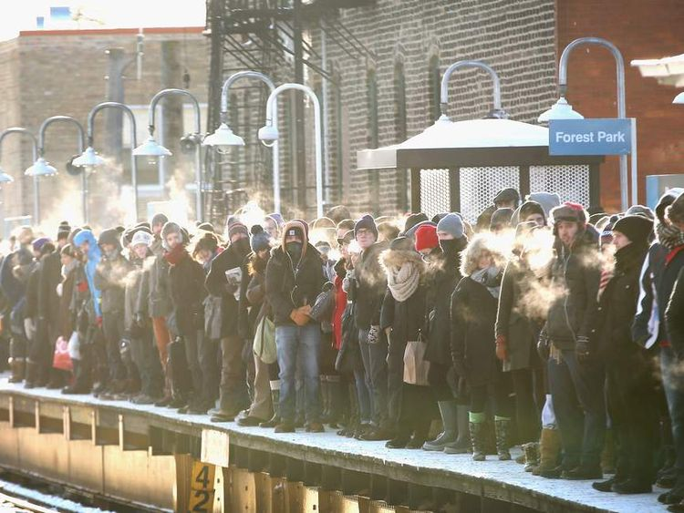 Passengers wait for trains in Chicago