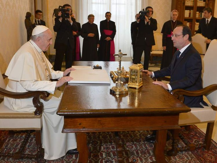 French president Francois Hollande meets with Pope Francis at the Vatican