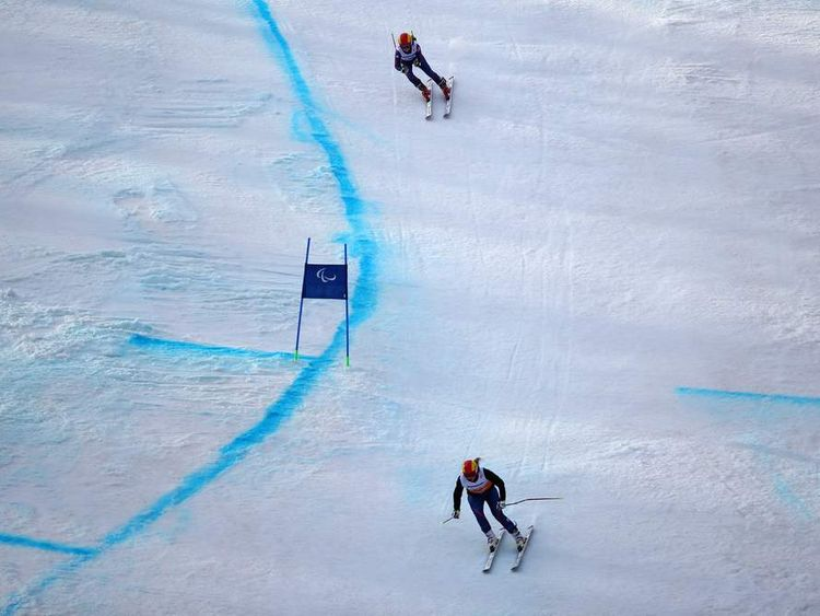Jade Etherington competes in the women's downhill event at the Winter Paralympics in Sochi with her guide Charlotte Evans.