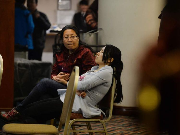 Relatives of passengers from the missing Malaysia Airlines Boeing 777-200 plane wait for news at a hotel in Beijing