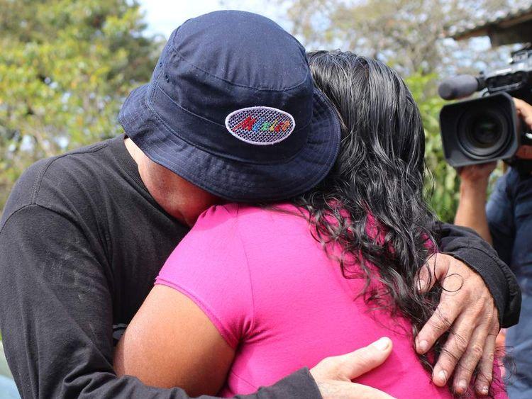 Salvadorean castaway Jose Salvador Alvarenga (L) embraces Roselia Diaz (R), mother of dead castaway Ezequiel Cordoba