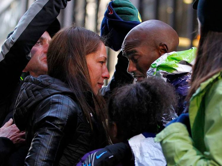 Mo Farah of Great Britain is looked after by his wife Tania after he collapsed at the finish line