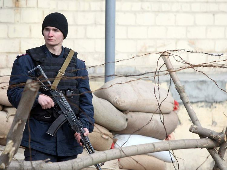 An Ukrainian soldier stands as he patrols on the territory of a military base in Donetsk