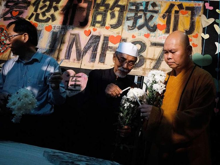 Malaysians remember passengers of Malaysia Airlines flight MH370.