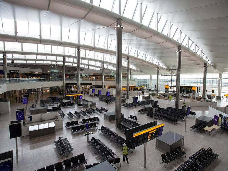 A man walks in the under-construction departure lounge of Heathrow airport's new Terminal 2.