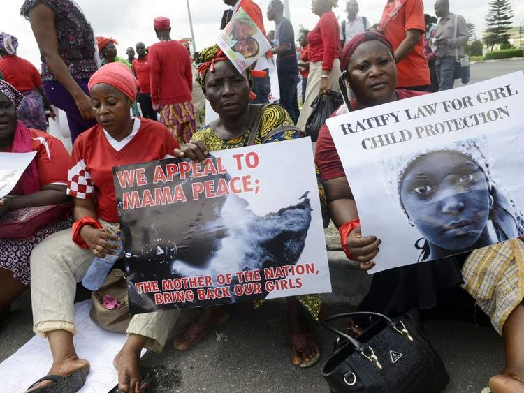 Women hold signs as members of Lagos based civil society groups hold a rally calling for the release of missing Chibok school girls at the state government house, in Lagos, Nigeria, on May 5, 2014.