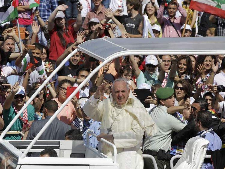 Pope Francis waves to pilgrims in Amman stadium, Jordan