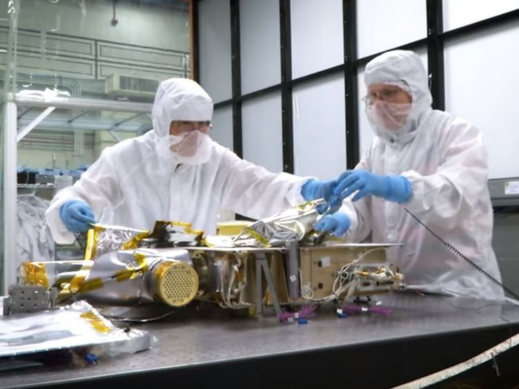 The team puts the finishing touches to the spacecraft Pic: NASA