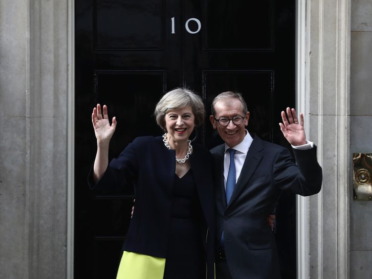 Theresa May and husband Philip wave outside 10 Downing Street