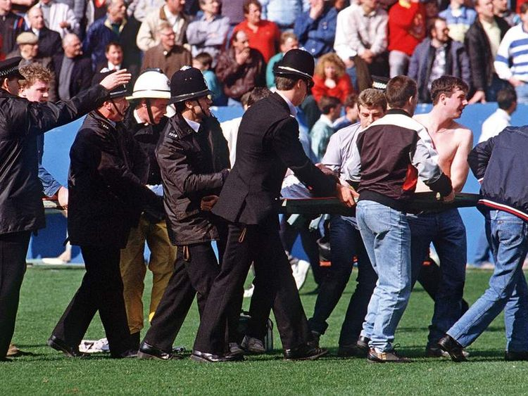 Policemen rescue soccer fans at Hillsborough stadium