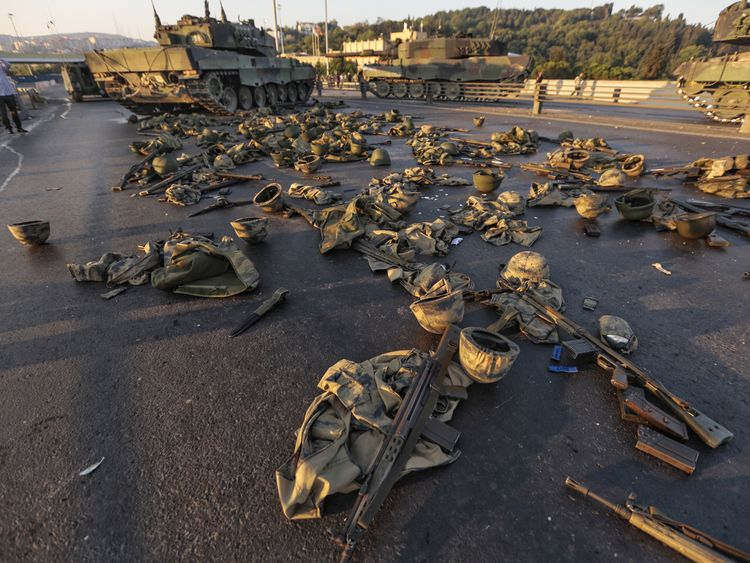 Clothes and weapons belonging to soldiers involved in the coup attempt are left on the street