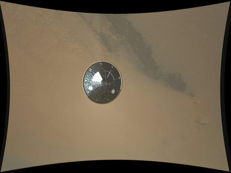 This color full-resolution image showing the heat shield of NASA's Curiosity rover was obtained during descent to the surface of Mars on Aug. 5
