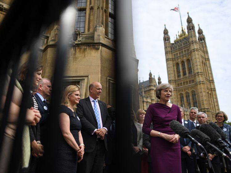 Theresa May with supporters outside Parliament