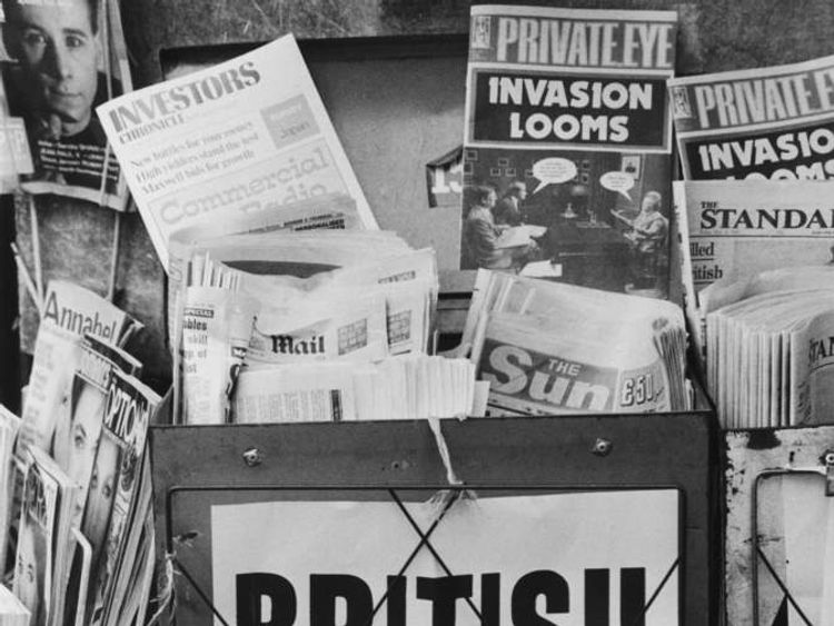 An Evening Standard headline on a London newspaper stand during the Falklands War reads 'British Troops Go In', May 1982