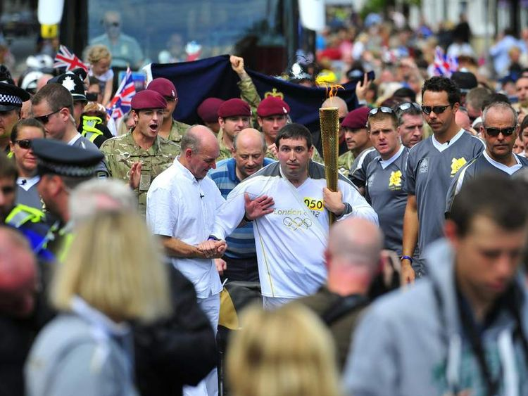 Ben Parkinson Carries Olympic Torch