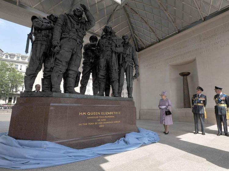 Queen Elizabeth II unveils the Bomber Command Memorial in Green Park, London, watched by the Duke of Edinburgh and the Prince of Wales