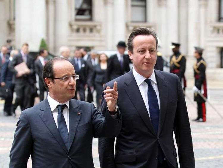 French President Francois Hollande (left) is greeted by Prime Minister David Cameron at the Foreign and Commonwealth Office in London, to mark the French president's first visit to Britain since taking office.