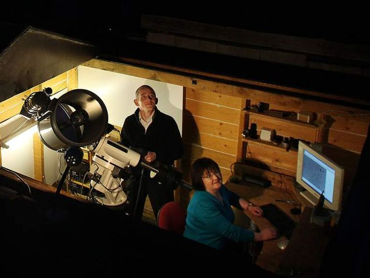 Amateur Astronomer Dave Grennan and his wife Carol in their back-garden observatory