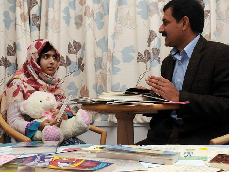 Malala Yousafzai with her father in UK Hospital