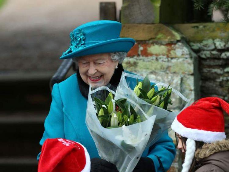 Queen Elizabeth receives flowers from children