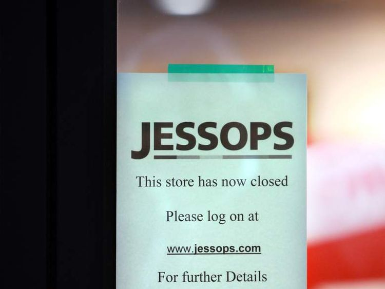 A sign on the door of a Jessops camera shop in Birmingham informing customers that it is now closed