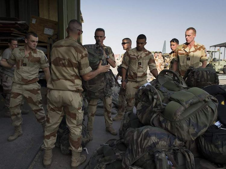French soldiers prepare to board a flight to Mali at at a French base in Chad