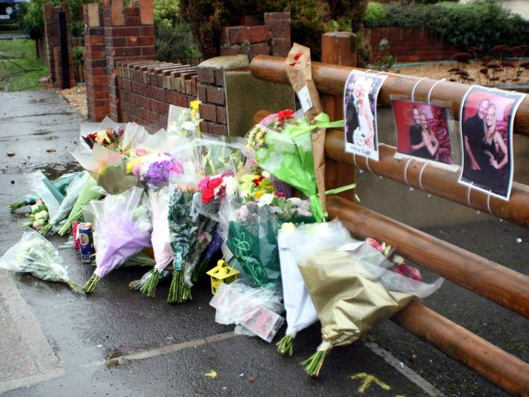 Floral tributes and pictures left at the scene in Hanham, near Bristol, in tribute to Ross and Clare Simons, who were killed yesterday when their tandem bike was struck by a car. PRESS ASSOCIATION Photo. Picture date: Monday January 28, 2013. Police arrested a 38-year-old man on suspicion of causing death by dangerous driving and a 35-year-old woman, on suspicion of dangerous driving. See PA story POLICE HitRun. Photo credit should read: Rod Minchin/PA Wire
