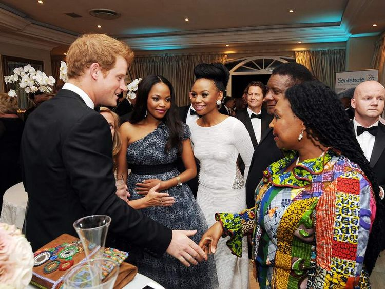 Prince Harry talks to guests at a drinks reception at the Sentabale Gala dinner