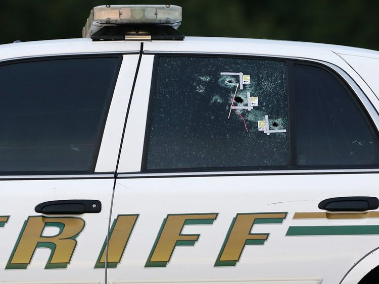 Gunshots can be seen in the window of a Sheriff's car in Baton Rouge, where six people were shot