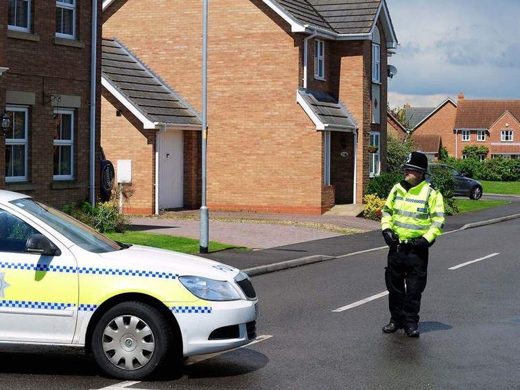 Police close a road in Saxilby, Lincolnshire leading to a house which was raided in connection with the attack in Woolwich, London
