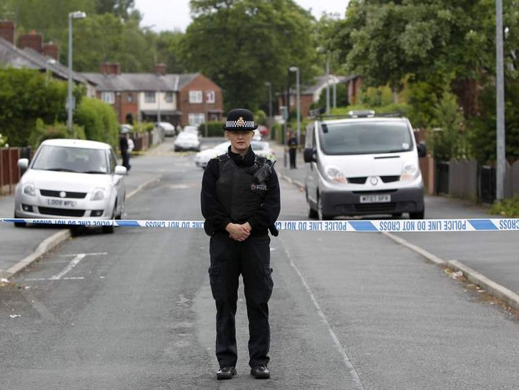 Police officers at the scene where Linzi Ashton was found dead