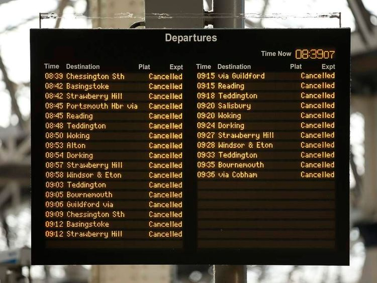 Cancellations caused by the storm are shown on a departures board at Waterloo station