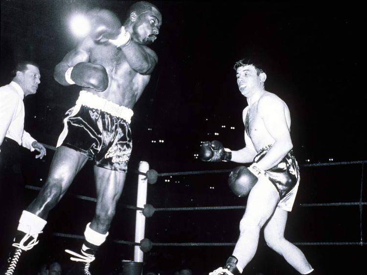 Rubin Carter in action against Harry Scott during their fight at the Royal Albert Hall in London in 1965