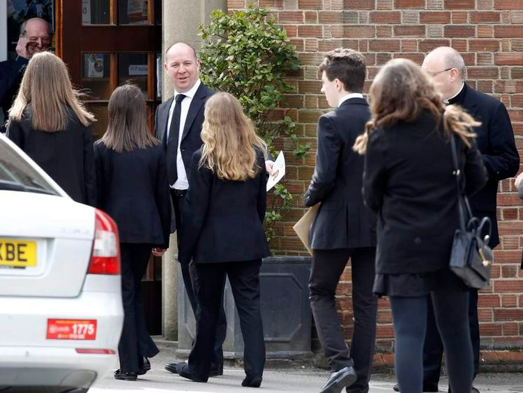 Mourners arrive for Ann Maguire's funeral.
