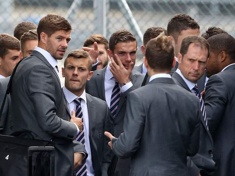 Comedian Simon Brodkin (back to camera), Steven Gerrard (left) Jack Wilshere (second left) and Jordan Henderson.